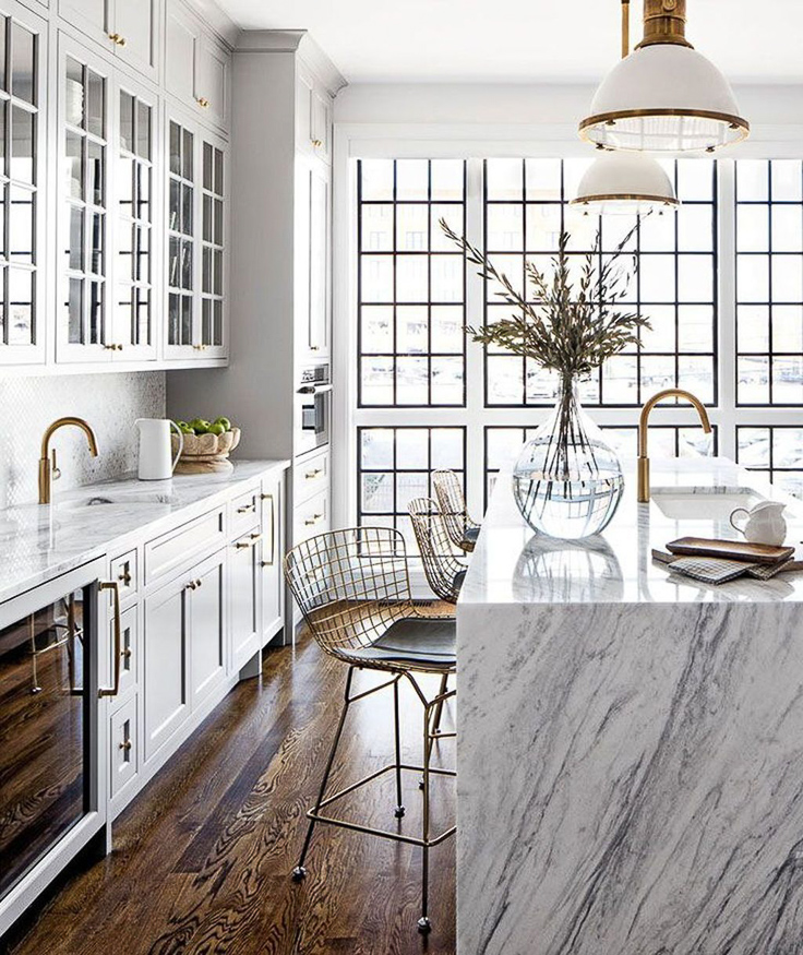 While waterfall countertops are not new, I believe we'll see them popping up in more traditionally inspired kitchens this year.  Kitchen Trends 2019 . #kitchentrends, #luxurykitchens, #kitchendesignideas