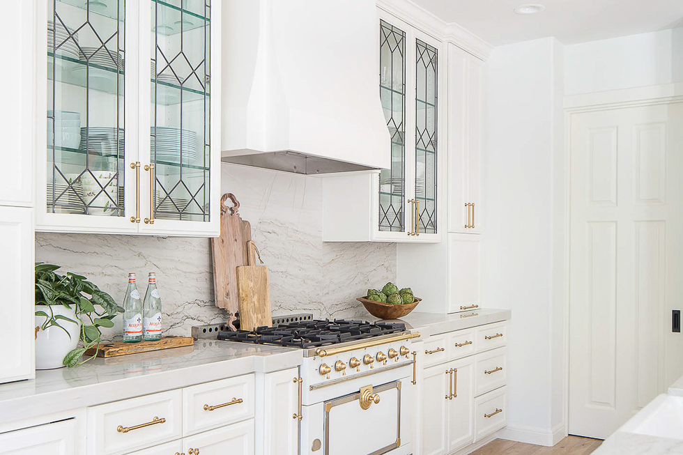 Lovely leaded glass doors are experiencing a resurgence in appreciation. They look particularly fresh again when used in white kitchens.  Kitchen Trends 2019 . #kitchentrends, #luxurykitchens, #kitchendesignideas