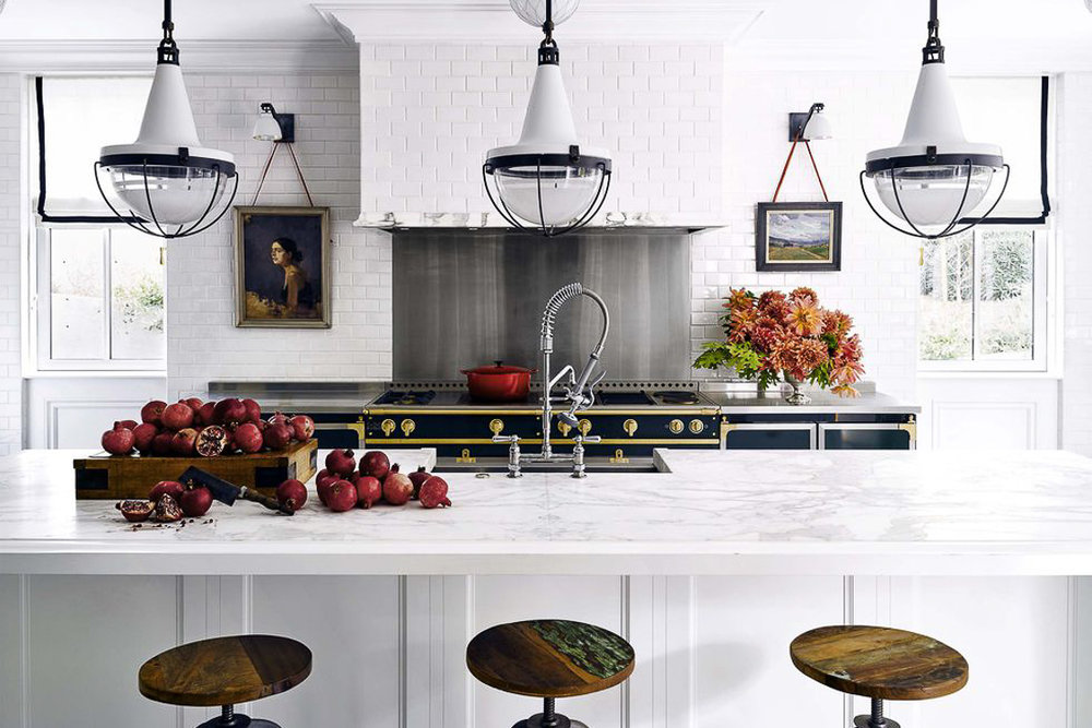 I predict that we'll see more tiled range hoods in traditional and transitional kitchens this year. When the idea is used well, the range hood practically disappears, allowing other design elements to take center stage, such as the Black La Cornue French range in this kitchen by Ken Fulk. Kitchen Trends 2019. #kitchentrends, #luxurykitchens, #kitchendesignideas