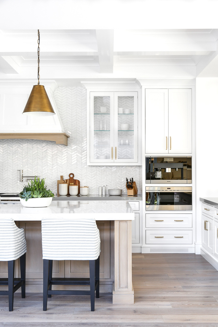 Backless cabinetry is trending in 2019. It's a great way to make the upper cabinetry appear visually weightless and to showcase a fabulous tile.  Kitchen Trends 2019 . #kitchentrends, #luxurykitchens, #kitchendesignideas
