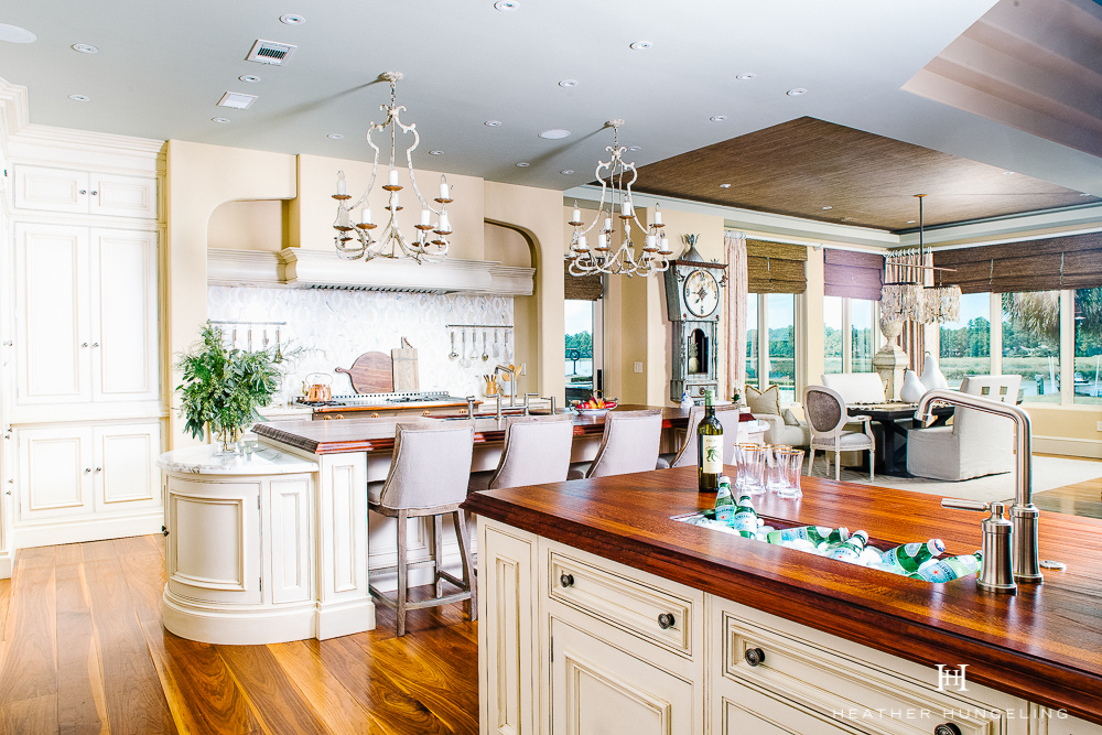 Willow Lane Project Reveal: A double island kitchen opens up a formerly dark and cramped space. Each island has a dedicated and distinct purpose. The second island serves as a coffee-bar and beverage station for the family, as well as guests. #luxurykitchens, #kitchenlayout, #doubleislands, #clivechristian