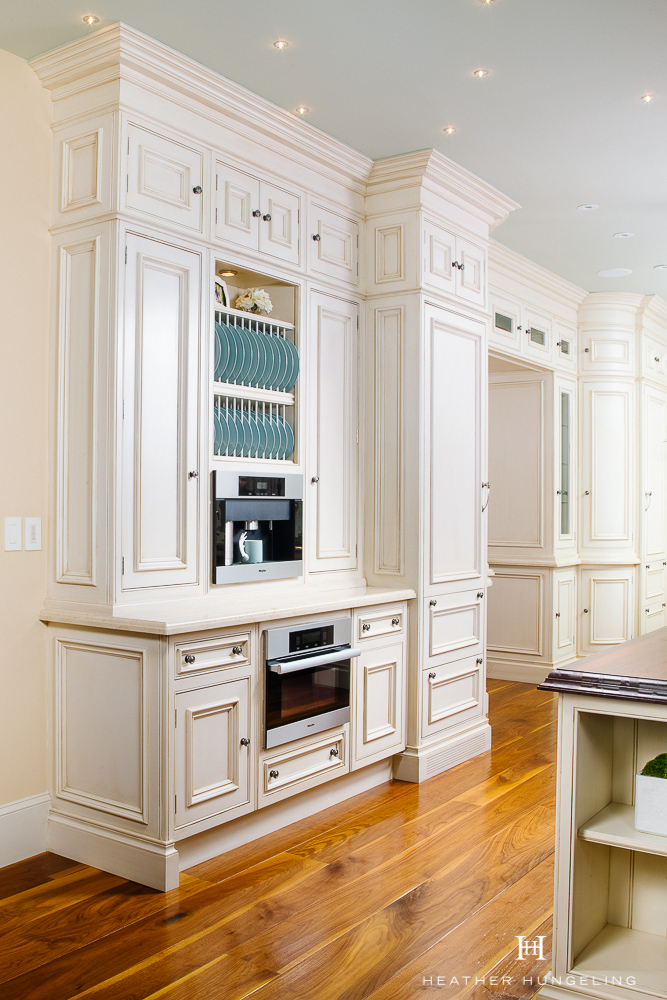 Willow Lane Project Reveal: Making sense of an unusual room shape is challenging. Find out how I did just that by creating a double island kitchen that solved several flow issues. It also created unique opportunities to build-in added function, like with this coffee bar. Featuring Miele coffee maker and speed oven. Painted cream cabinetry by Clive Christian.  #luxurykitchens, #kitchenlayout, #doubleislands, #clivechristian