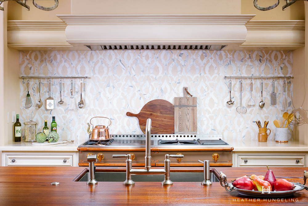 Willow Lane Project Reveal: See how I created a new double island kitchen for this family, which features many of my favorite luxury brands, such as this stunning La Cornue range in Cocoa. Patterned marble backsplash tile. Cabinetry by Clive Christian. #luxurykitchens, #kitchendesign, #clivechristian, #lacornue