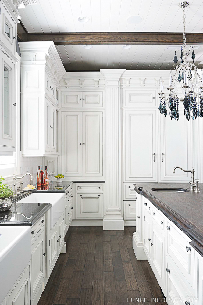 The typical work triangle is an outdated concept in today's luxury kitchen layout. Focus instead, on creating functional work zones scattered throughout your space. #luxurykitchendesigns, #clivechristian, #traditionalkitchens, #kitchenlayoutideas