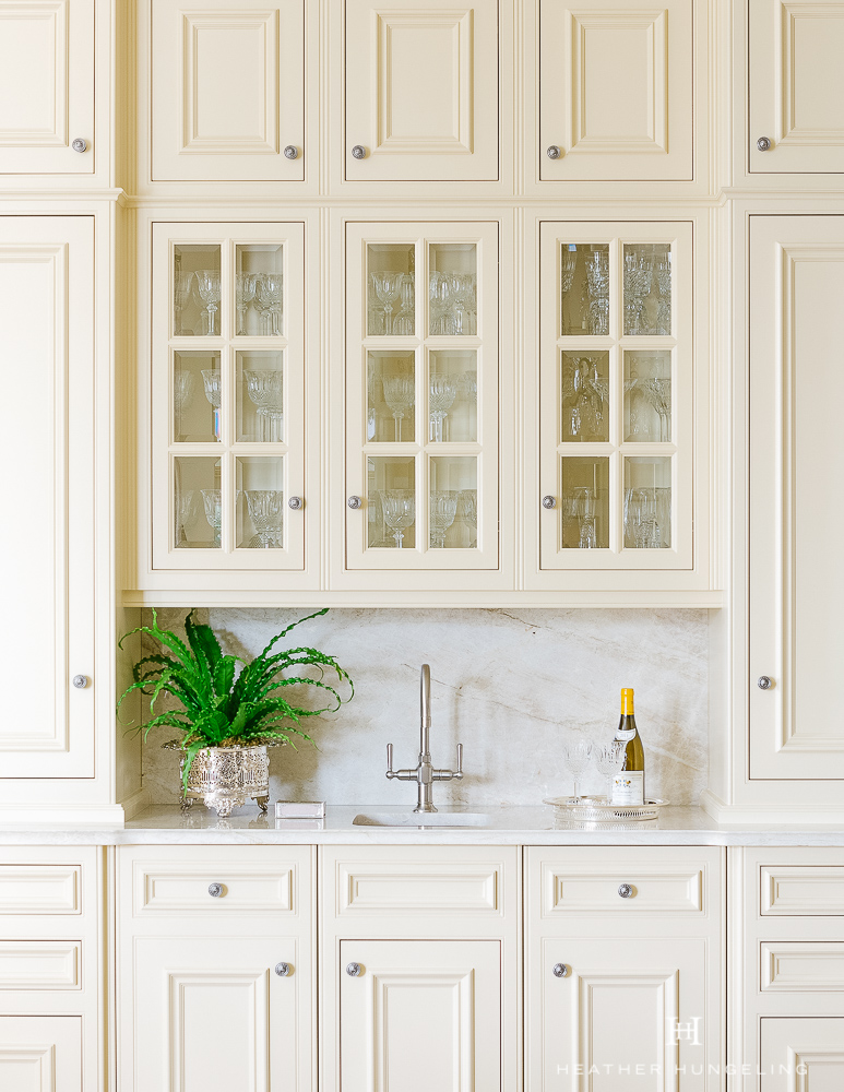 """Kitchen Cabinetry Design Mistake #2: Avoid single-door wall cabinetry that measures 24"""" wide and double-door wall cabinetry that measures 28"""" wide. Both of these sizes are unsightly in a well-designed kitchen. Note the correct and elegant proportions of the glass doors in this image. #kitchencabinetrydesign #luxurykitchendesigns, #clivechristian, #traditionalkitchens,"""