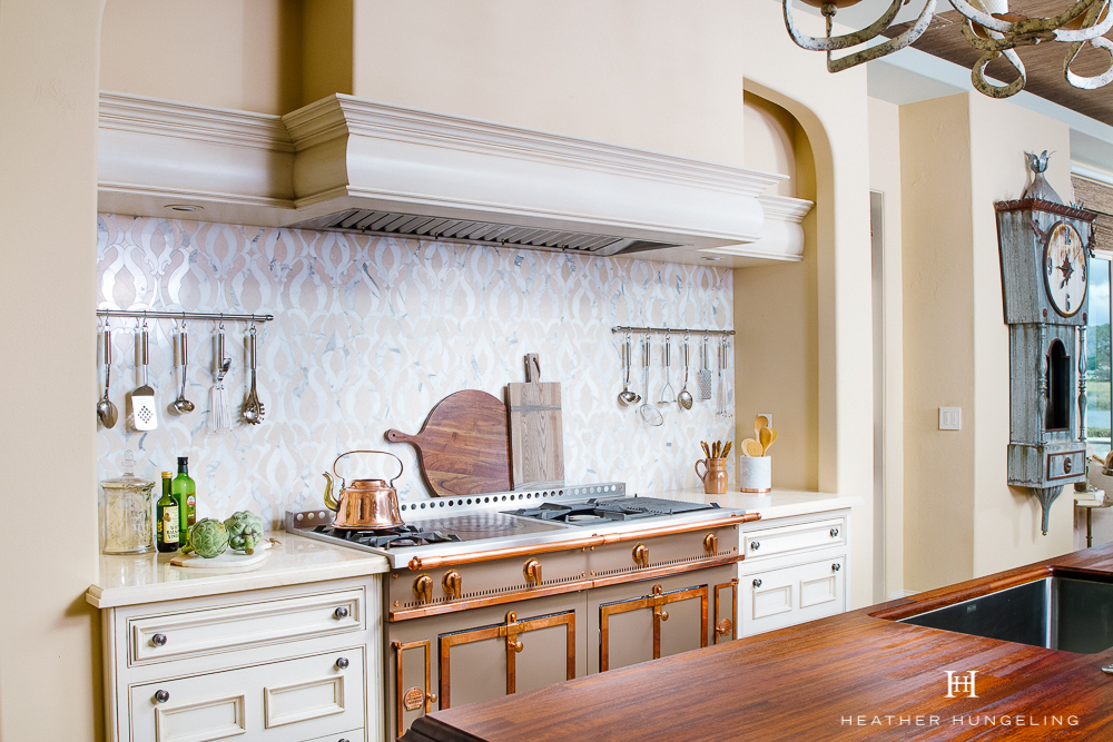 Kitchen Cabinetry Design Mistake #1: Roll-out shelves inside of base cabinets offer up convenience in certain situations. However, it's almost always better to opt for drawers, which require only one movement to open them. #kitchencabinetrydesign #luxurykitchendesigns, #clivechristian, #traditionalkitchens,