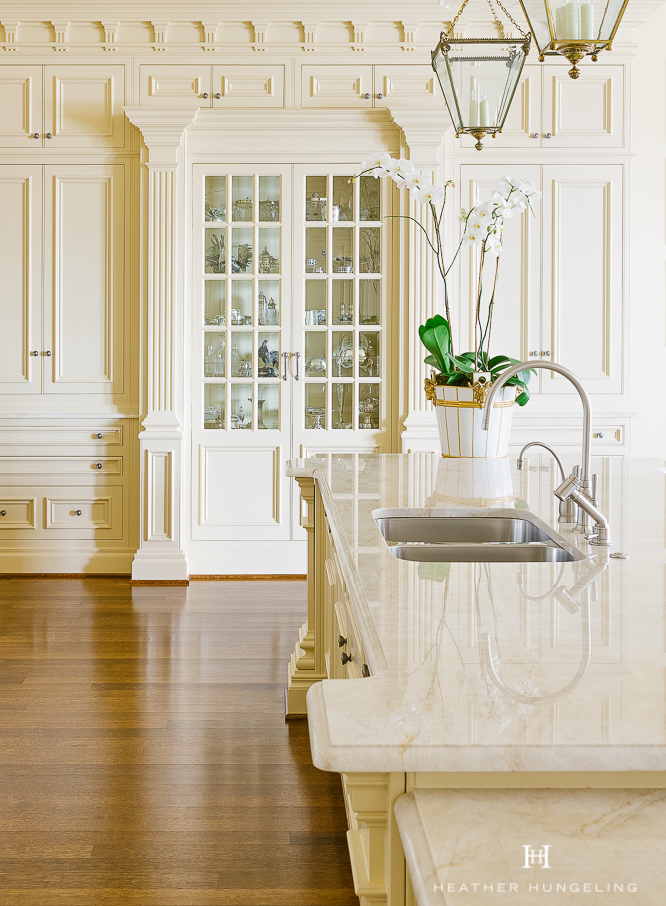 Quartzite (a natural stone) is a fantastic alternative to marble because it does not etch. This kitchen features Taj Mahal quartzite, which has become a prevalent option in recent years.  #kitchencountertops, #quartzcountertops, #luxurykitchendesigns #traditionalkitchens