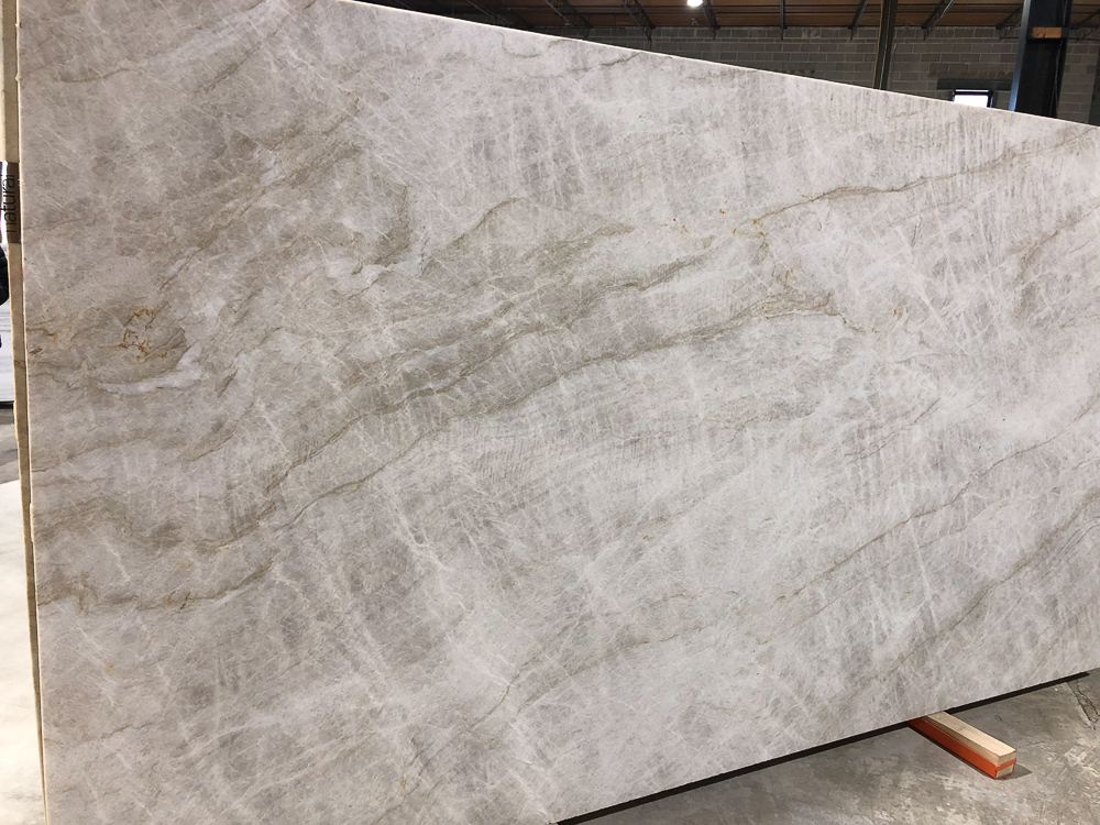 Taj Mahal Quartzite offered by  Pietra    Luxury in Stone   in Atlanta, GA. Quartzite, a natural stone, is a great alternative to marble for kitchens because it does not etch.  #kitchencountertops, #marblecountertops, #luxurykitchendesigns #traditionalkitchens