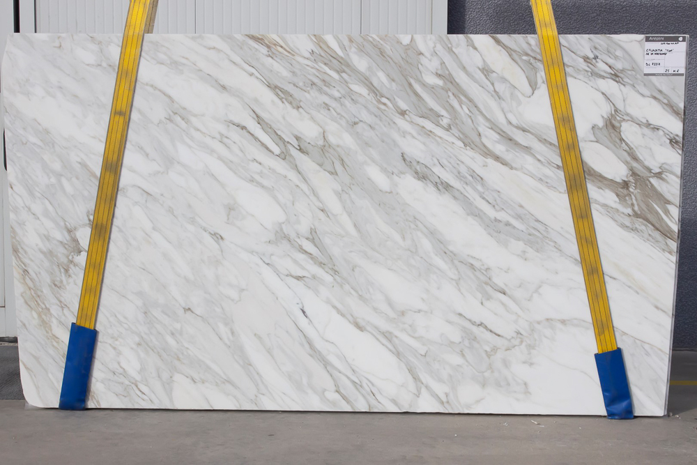"""AZEROCARE (in """" Calacatta Top """") marble is a proprietary product offered by Italian company Antolini. They have developed a patented process which provides consumers with a natural marble that will not stain or etch. This beautiful featured slab is offered by  Pietra    Luxury in Stone   in Atlanta, GA, an exclusive provider of Antolini's line of AZEROCARE marbles.  #kitchencountertops, #marblecountertops, #luxurykitchendesigns #traditionalkitchens"""