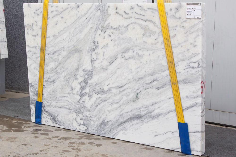 """AZEROCARE (in """" White Super """") marble is a proprietary product offered by Italian company Antolini. They have developed a patented process which provides consumers with a natural marble that will not stain or etch. This beautiful featured slab is offered by  Pietra    Luxury in Stone   in Atlanta, GA, an exclusive provider of Antolini's line of AZEROCARE marbles.  #kitchencountertops, #marblecountertops, #luxurykitchendesigns #traditionalkitchens"""