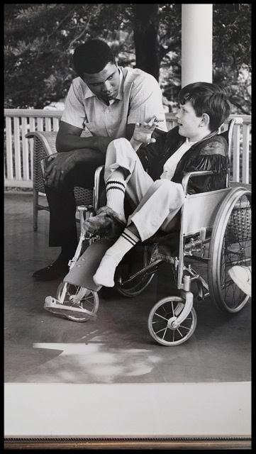 """Bob Massie, age 9, with Muhammad Ali in 1966. Photo by Gordon Parks"""