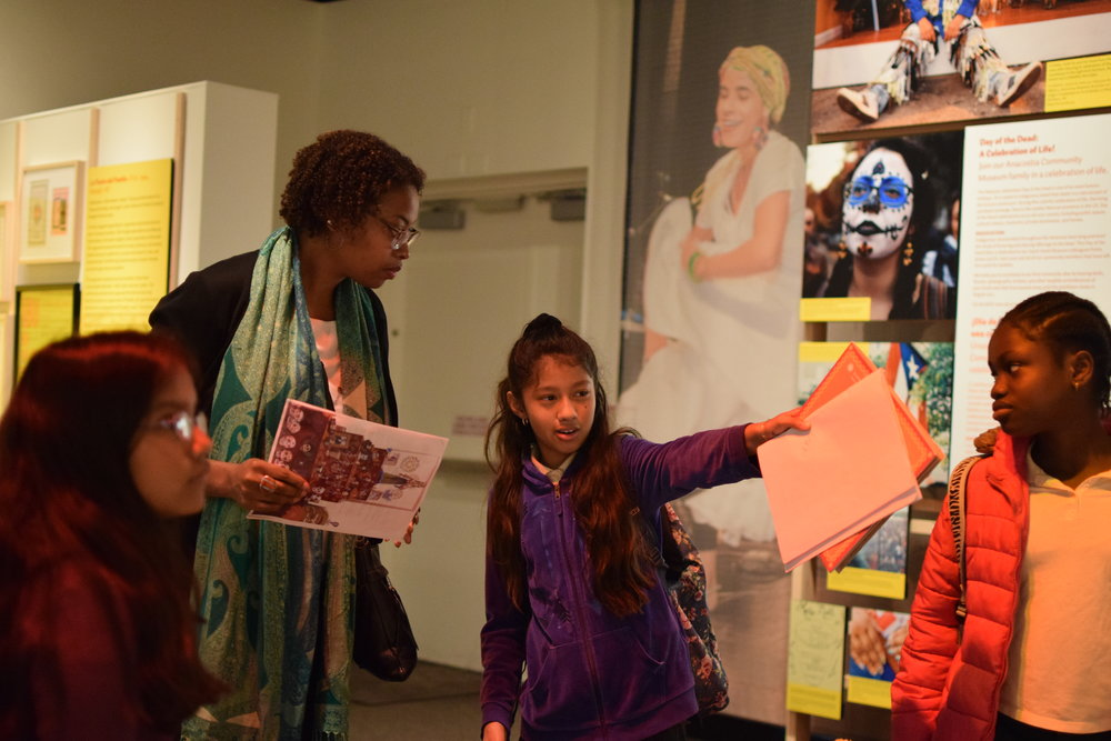 Curator Ariana Curtis with students at the Anacostia Museum. Photo by Elena Young.
