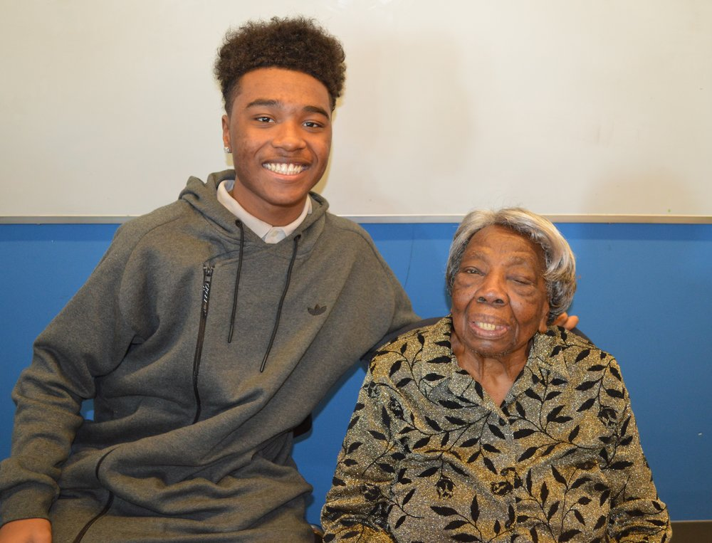 A student with Ms. Virginia McLaurin.