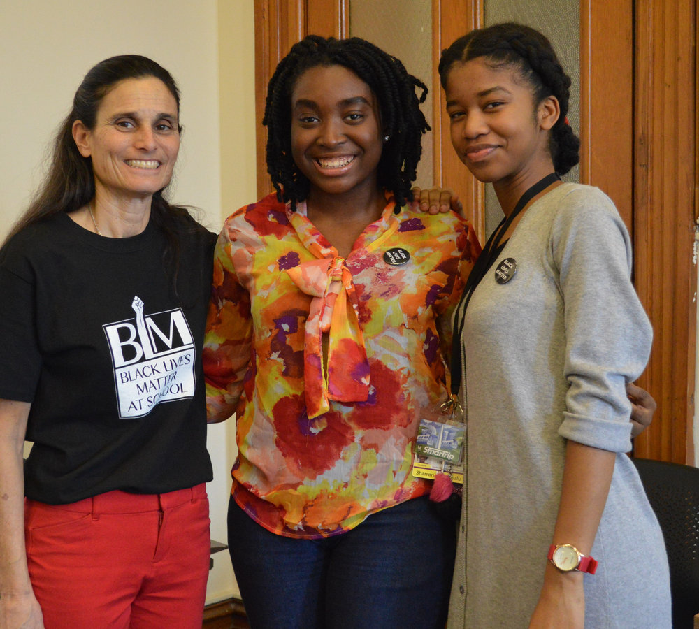 Teacher Jill Weiler and student discussion leaders for the second class, Golden Emokpaire and Sharron-Rose Kisalu.