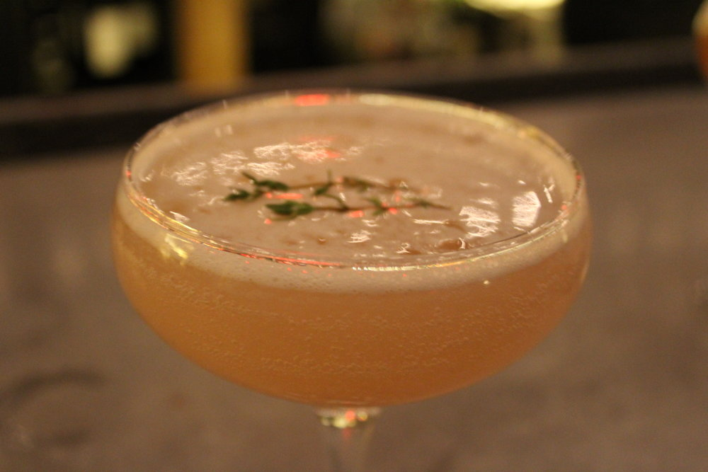 MARTINI THYME - Plymouth Gin, thyme, lime, peach puree, topped with prosecco