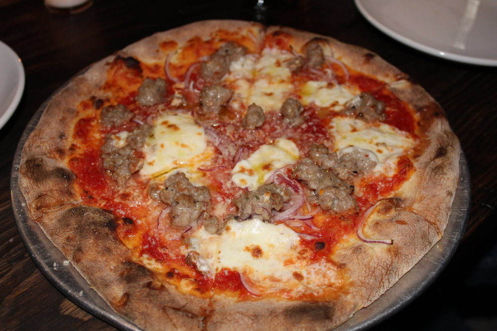 Italian Sausage Pizza - red sauce, crumbled house-made Italian sausage, sliced onion, mozzarella