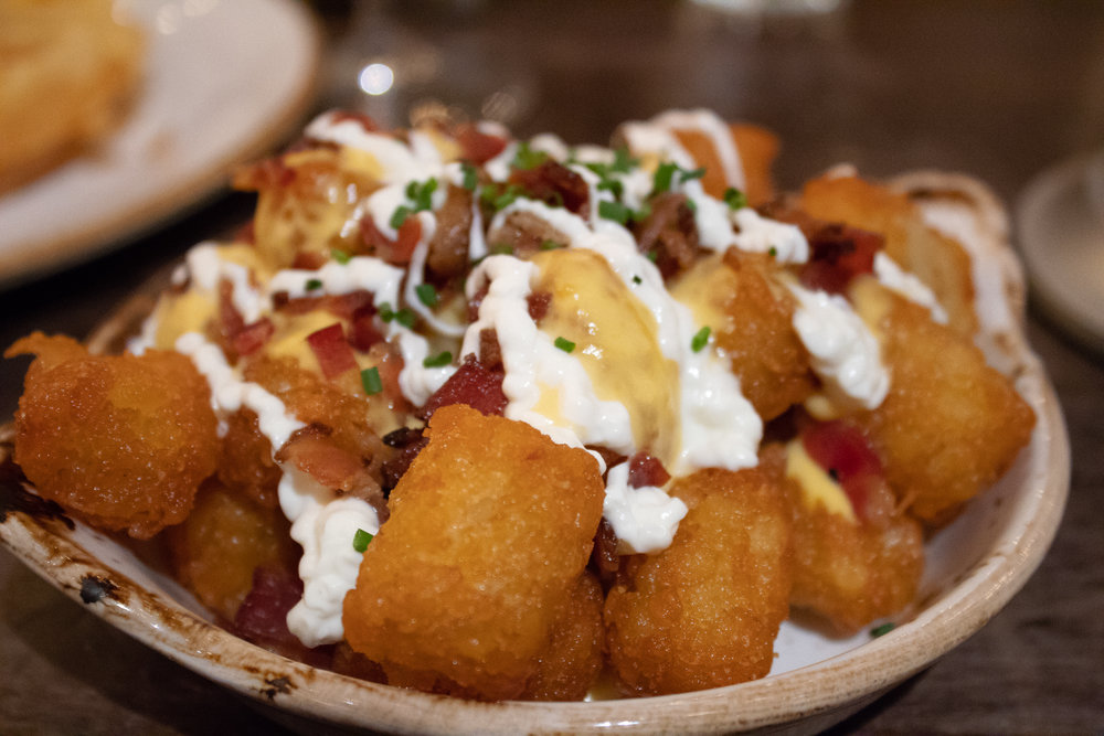 Loaded tater tots - bacon, sour cream, and chesse