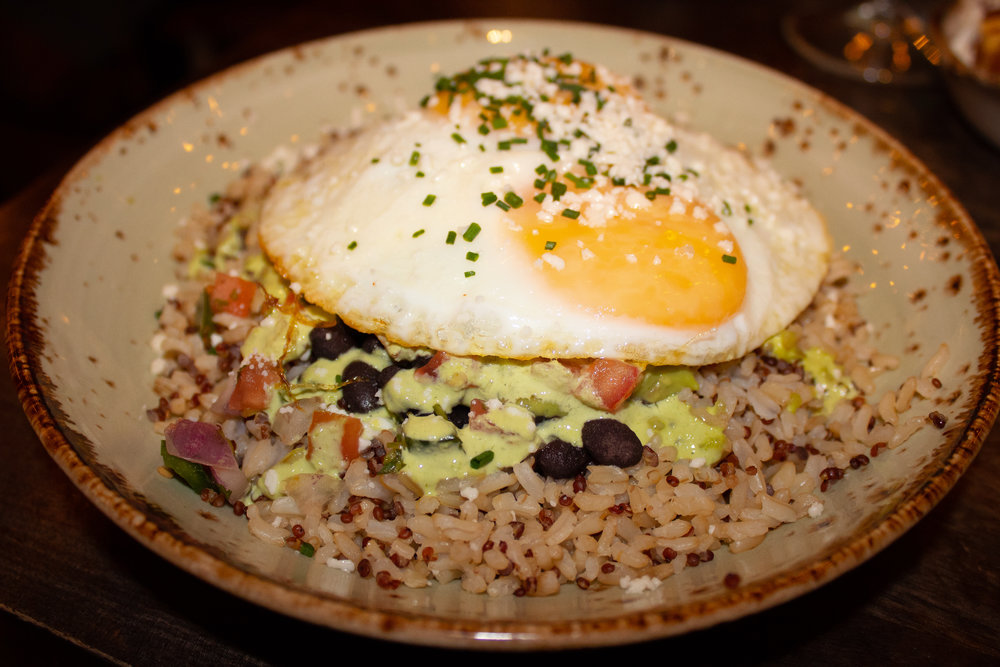 Brunch bow - whole grains, beans, guacamole, salsa, cheese, chicken, and fried egg