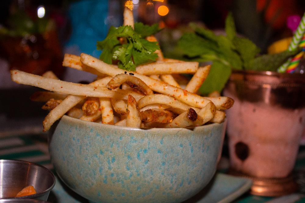 Togarashi Fries - saffron, black garlic, and sriracha aioli