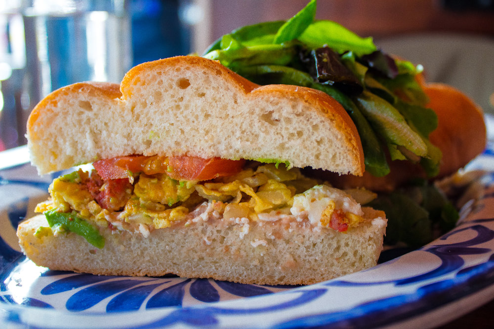 Torta manrera - Scrambled eggs, chorizo, black bean spread, queso oaxaca on telera bread