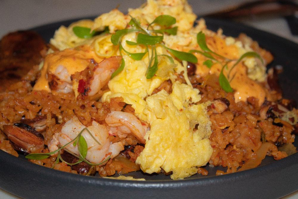 """Locrio"" - shrimp fried rice and beans, 2 sunny eggs, kimchi slaw, Beatstro sauce"