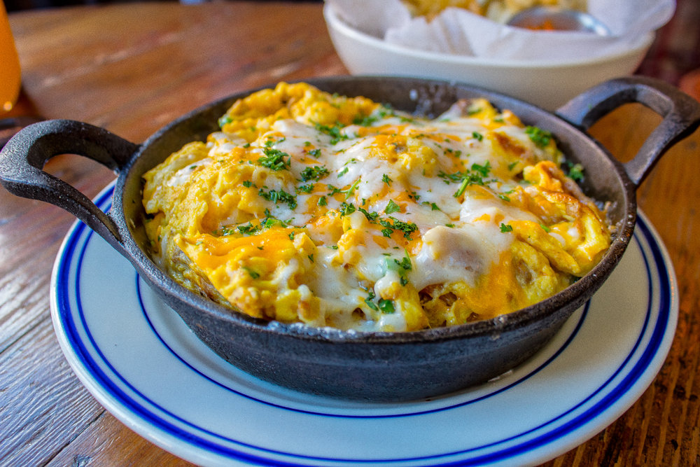 El Barrio Frittata - Eggs, house made Longaniza sausage, onion, potatoes, jalapeno, mozzarella, sharp cheddar, baked and served in a skillet