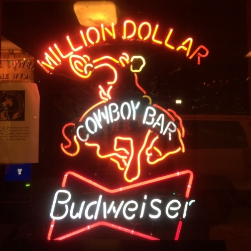 Put 'Em Back - The Million Dollar Cowboy Bar 25 N Cache St, Jackson, Wyoming 83001To visit Jackson Hole and not make a pilgrimage to the Million Dollar Cowboy Bar is nothing short of sacrilegious. From the live music, to the saddles that double as barstools, to the exuberant mix of actual cowboys and wannabe-cowboys, this is the bar not to be missed. Famous and popular for a reason, don't be too cool to experience this iconic saloon.The Mangy Moose 3295 Village Drive, Jackson, WY 83001Located at the foot of the mountain, the Mangy Moose is the prime après location after a day of skiing. The nachos are phenomenal, the music is live, and the drinks are stiff. And if your phone is dead after a day on the slopes, it's pretty much guaranteed you will find your friends here, saddled up at the bar.The Silver Dollar 50 Glenwood St, Jackson, Wyoming 83001Located in the Wort Hotel, the Silver Dollar (so-named for the proliferation of said currency embedded in the wooden bar) is where you go to attend to your country dancing needs. If you're too shy, order a round at the bar before throwing away your pride to the sounds of local bands; often including the cleverly named 'Jackson 6.'
