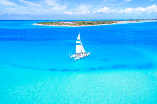 Good Times - Snorkeling in ProvidencialesProvidenciales, Turks & CaicosThis is a must: book a boating trip, or snorkeling, and dive for conch and sand dollars. Indulge in some rum punch, and let your captain teach you how to dance.