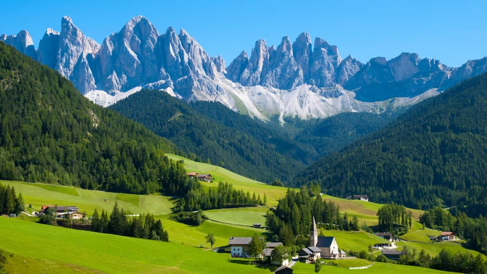 7. Dolomites, Italy - Now that Call Me By Your Name has officially established Northern Italy as the most romantic destination of the year, why not check out the Dolomites in the Northeastern regions of the country? Start your trip in Milan before heading up to the Italian Alps (which, unlike the Swiss Alps, are still in favor). Word to the wise: hiking these mountains in the middle of the summer is a sweat-inducing feat, so pack (and prepare) accordingly.