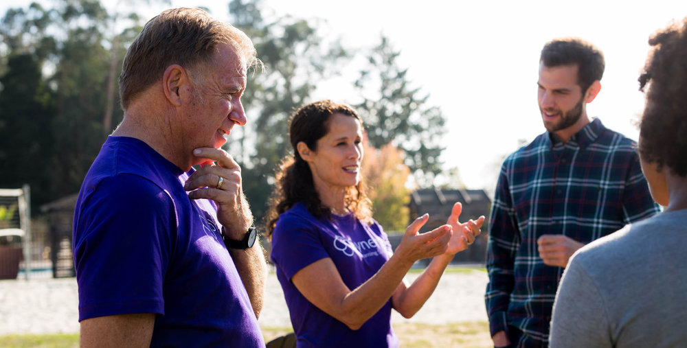 Two advisors facilitate a team discussion