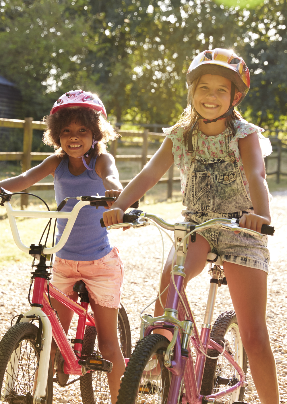 Two girls sitting on bicycles