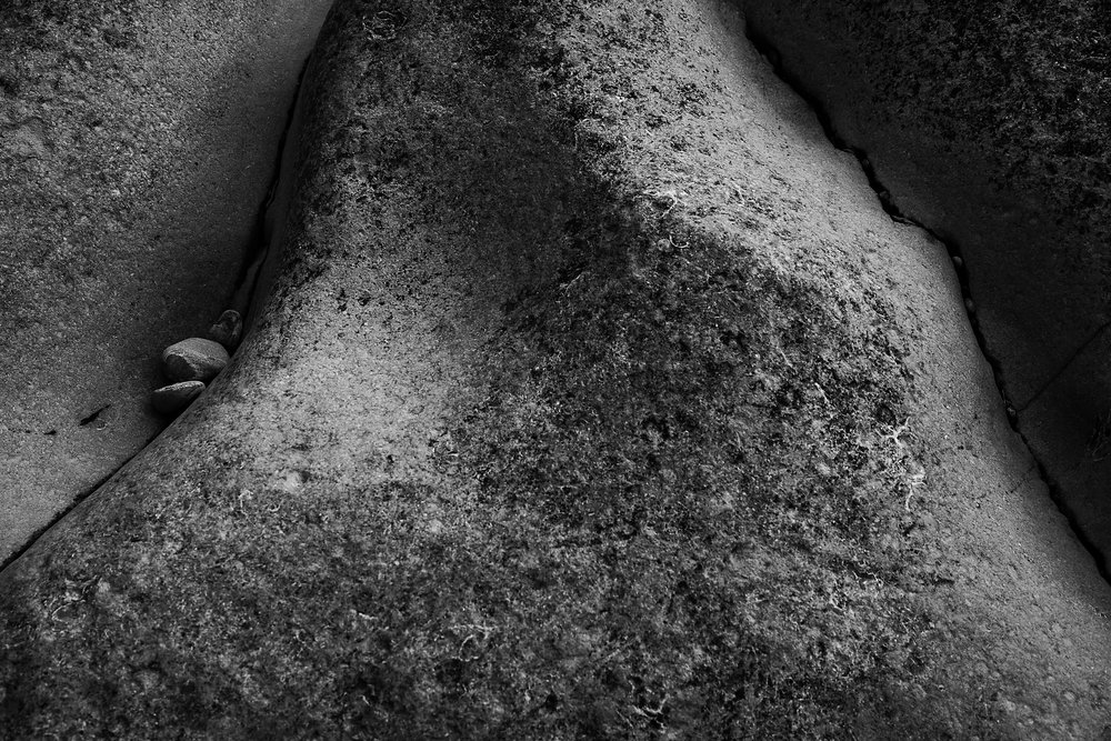 Portland Bill, 2017 - I first visited Portland Bill in Dorset in 1996. I was immediately struck by the myriad textures of the rock, some smoothed by waves and wind, others by hand tools from the historic quarry works.This series concentrates on the sensual nature of the subject matter through an emphasis on texture, form, and composition.20