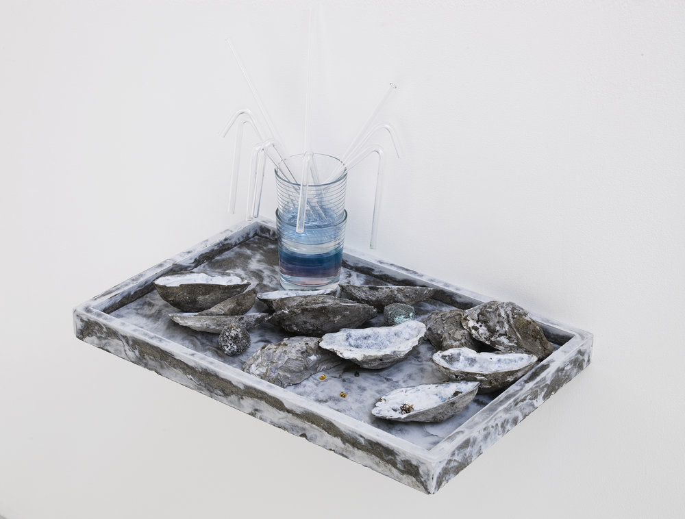 Victoria Adam, You but better (2). 2015. Cement, drinking glass, glass tube, liquid soap, earring backs, magnets, kettle defurrers, bath salts, various magnetic mixed media; 25 x 45 x 30 cm. Photograph: Andy Keate.