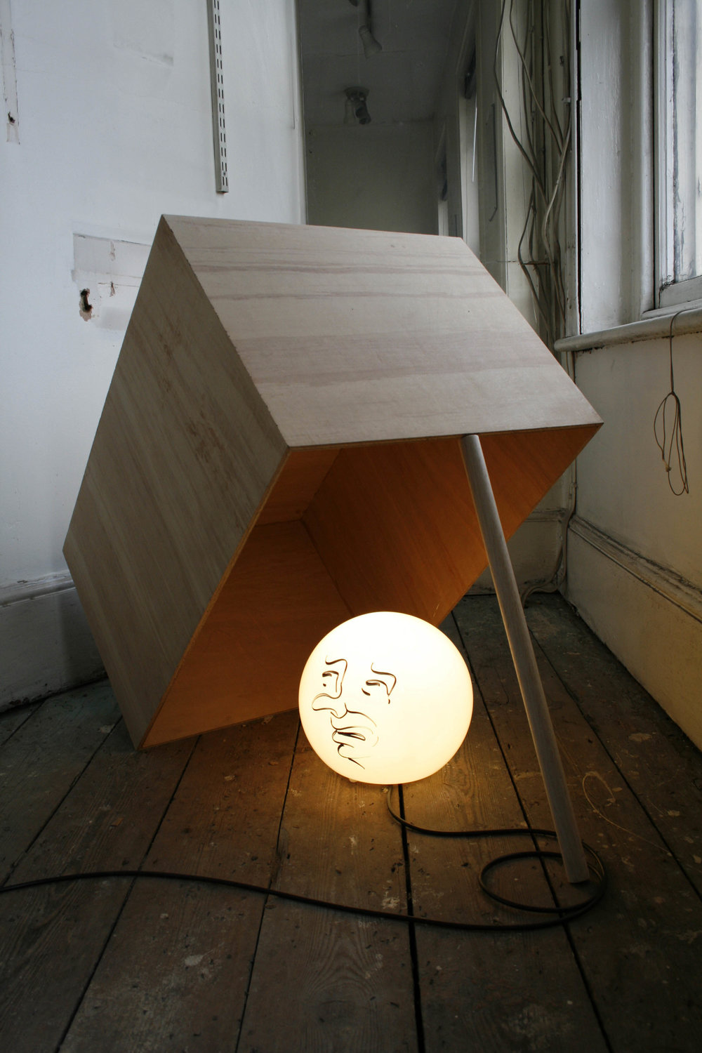 Sam Porritt, Looking For Trouble, 2009. Glass Lamp, Marker Pen, Plywood; 75 x 100 x 50 cm. Image courtesy of the artist.