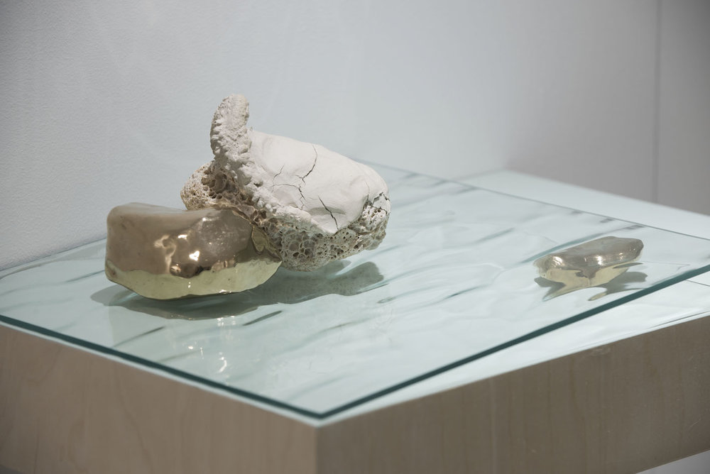 Kate McMillan, Untitled, 2016. Air drying plaster, rock, bronze, glass, cotton, acrylic paint, plywood; 20 × 45 × 30 cm.