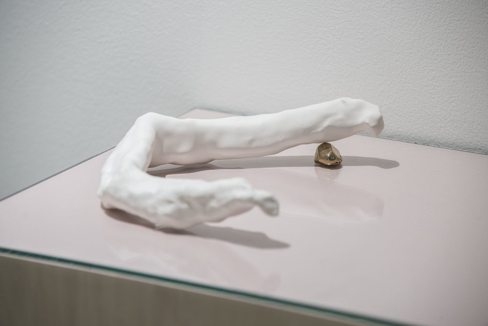 Kate McMillan, Untitled (detail), 2016. Plaster of paris, bronze, glass, print on paper, cotton, acrylic paint, plywood; 12 × 50 × 28 cm.