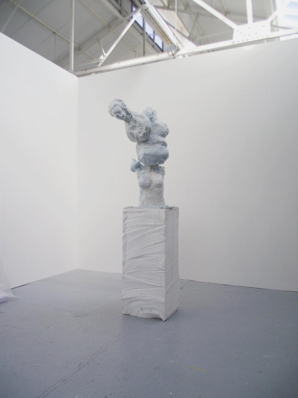 Jamie Fitzpatrick, Statue, 2015. Wax, Polyurethane Foam, Polystyrene, and Steel; 245 cm x 69 x 51 cm. Image courtesy of the artist.