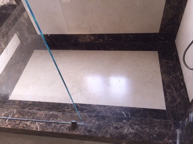 Invisible shower drain  - King's bathroom shower marble slab floor