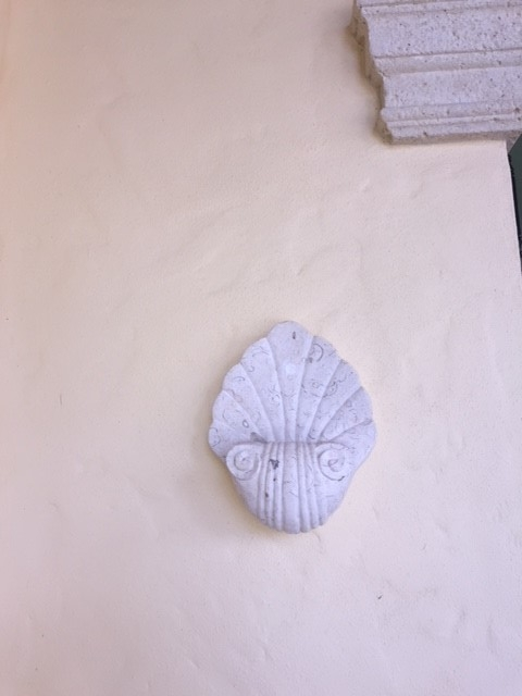 Carved shell-stone sconce in main loggia -