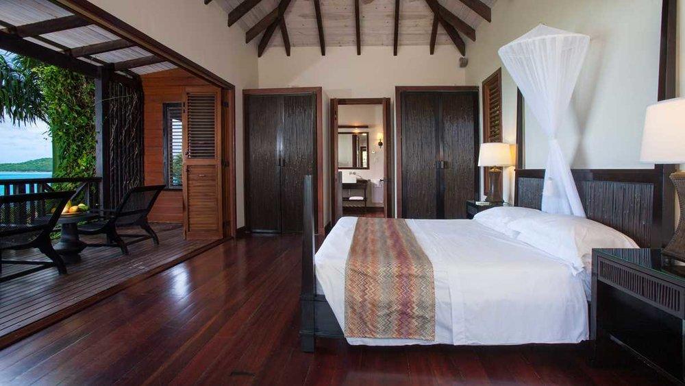 AntiguaBarbados-Hermitage-Res-HillsidePoolSuite-BedroomAlt-UHD.jpeg
