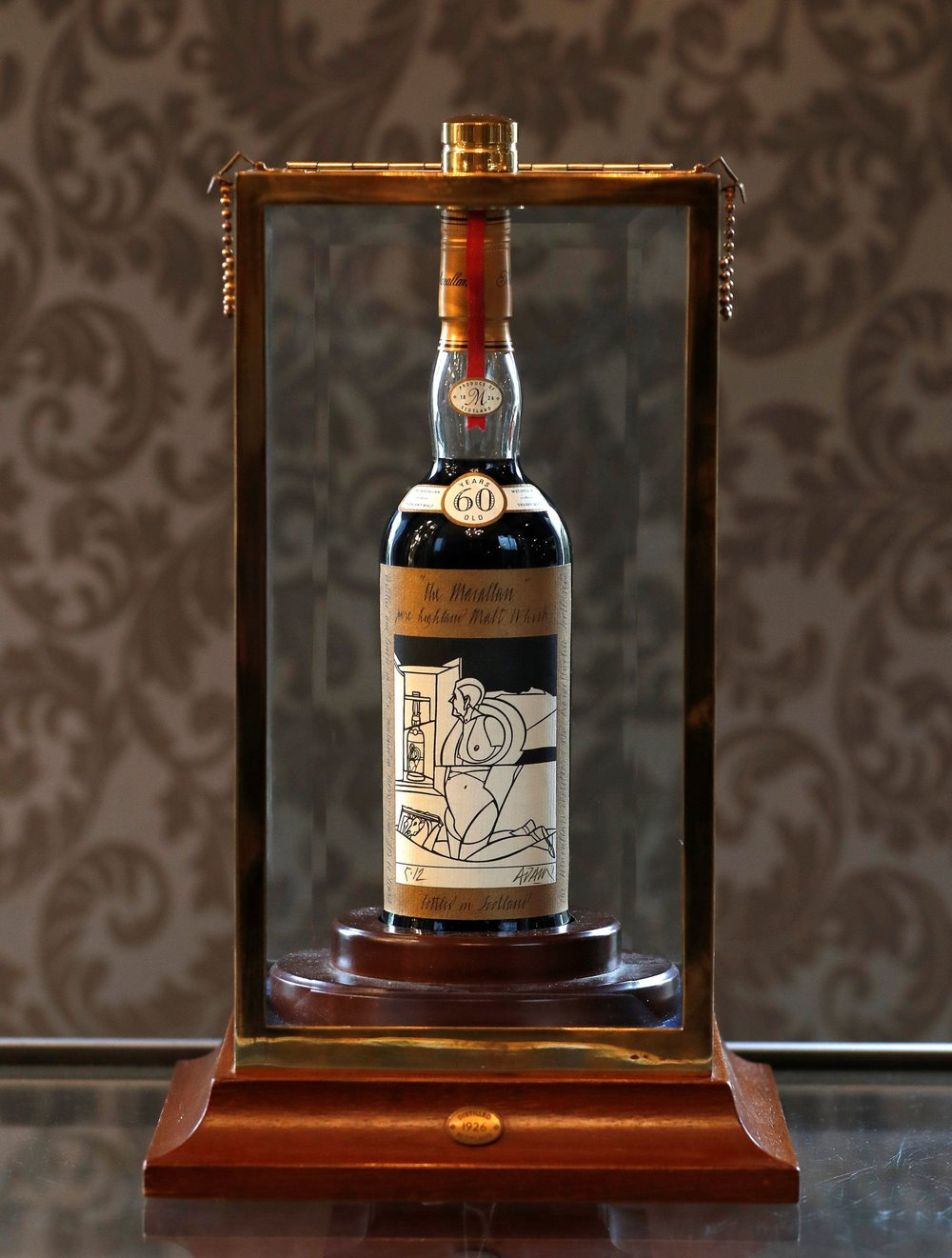 A 60-year old The Macallan Valerio Adami 1926 is seen in a glass case after it was auctioned for a record amount at Bonhams in Edinburgh, Scotland, Britain October 3, 2018. REUTERS/Russell Cheyne