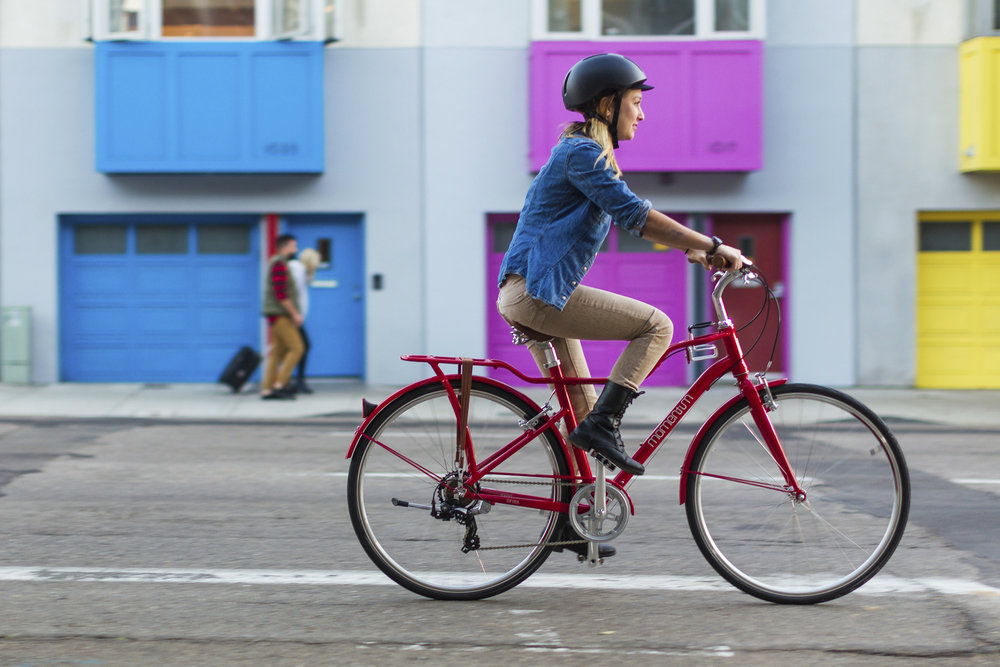 "Momentum - WITH A MOTTO OF ""MOVE HAPPY,"" MOMENTUM BIKES ARE SURE TO PUT A SMILE ON YOUR FACE. THESE CITY BIKES ARE THE PERFECT COMBINATION OF FUN AND FUNCTION."