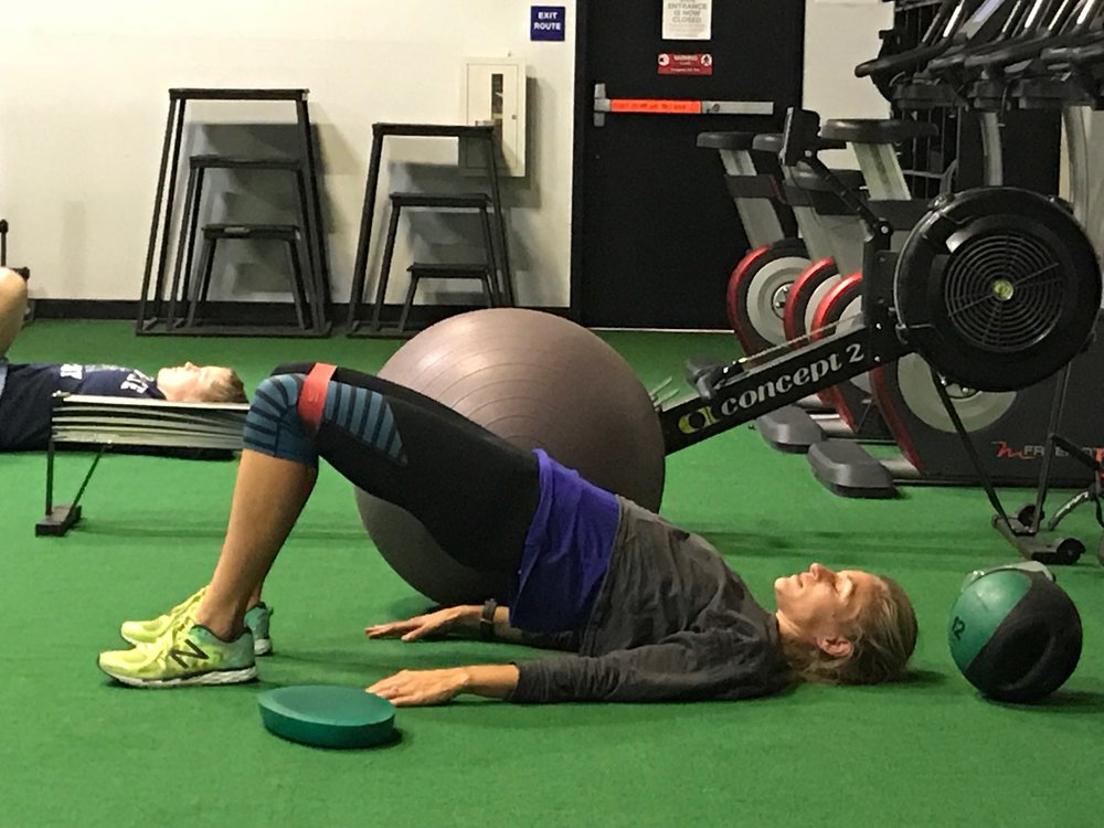 Glute Bridges - This is with a band. I add a tight band to help cue my glutes to activate. You want your hips up and your torso in a straigh line, as shown.