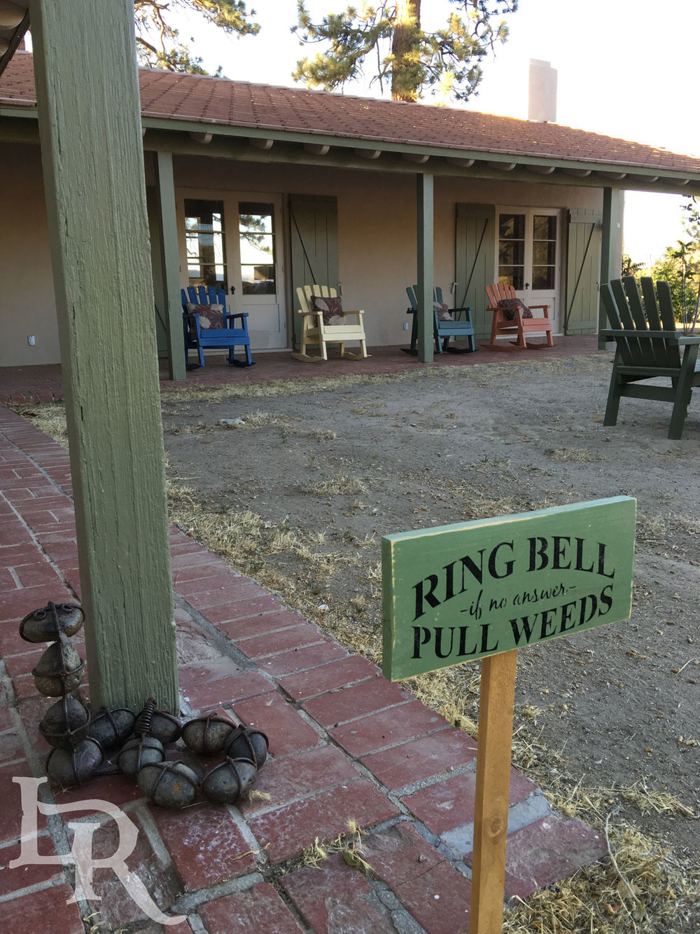 Pull-weeds-sign-by-fire-pit.jpg