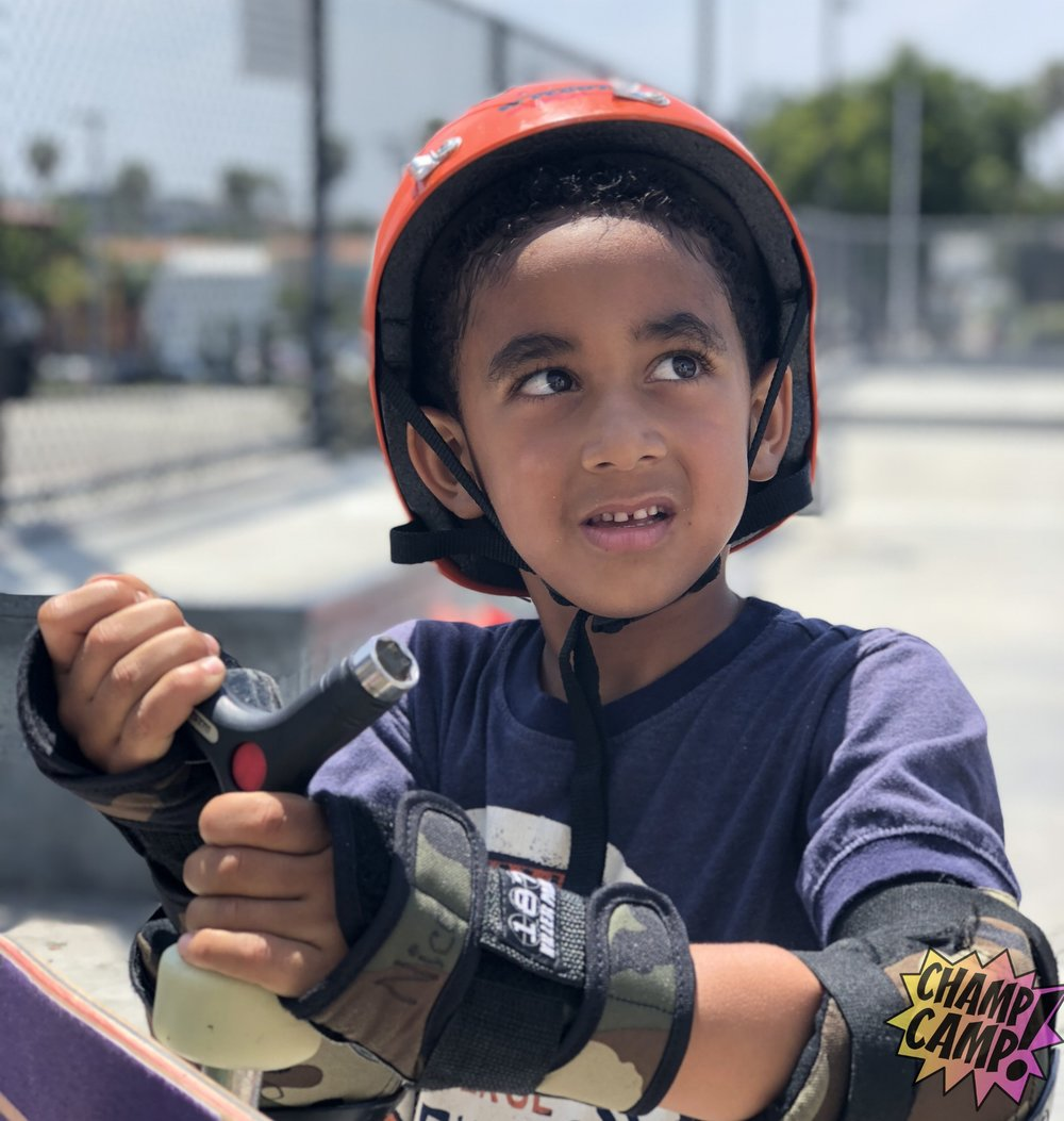 CHAMP SKATE CAMP - AT the CHAMP SKATE CAMP,we leave the beach for the board to instruct little ones on the basic, intermediate, and advanced skills needed to shred on that glorious piece of wood called a skateboard! Through tons of High Fives & Smooth Rides, we aim to help your little one reach new heights... Let's Roll!