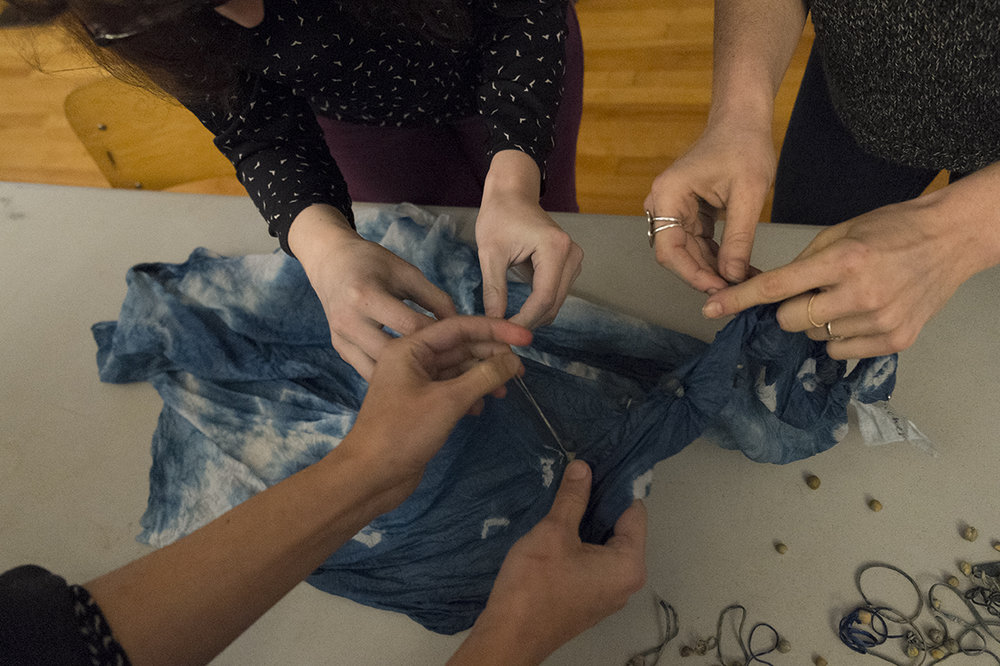 "Thinking With Your Hands: An Afternoon of Indigo Shibori and Fort Building - On November 19, 2016 Caroline Ballhorn and Jenny lee Craig led an afternoon of textile dying, fort building and discussion about the nature of the creative process. Participants practiced the art of Shibori with natural indigo dye. All participants went home with a piece of indigo shibori that they have made themselves on 100% cotton and information on how to continue to practice indigo shibori at home.Tin Can Studio is a mobile project space housed in a vintage 18ft Streamline trailer. Their fully mobile portable studio has been designed to transform to accommodate a variety of creative activities, and acts as a incubator, a hub, and an event space. They love to transform and pop-up in unexpected locations, where they can engage with a diversity of communities. They work with institutions to develop unique programs centered on community building, host their own incredible events and workshops, and create unforgettable experiences for weddings and other celebrations. Tin Can Studio consists of Jenny Lee Craig and Caroline Ballhorn.Jenny Lee Craig is an artist and a creative facilitator. Her projects are diverse and interdisciplinary, and often aim to be community engaged. The extensive list of her life's highlights so far include competing in FINA World Championships with her Synchronized Swimming team, writing a play about a tender jewel that goes for a journey in a giant hat, and playing the role of ""Applause Sign Holder"" in a most spectacular rendition of the hit musical AnnieCaroline Ballhorn is a Vancouver-based artist, designer, and creative facilitator with a background in sculpture, print-making, drawing, textile-based and social/community-based/participatory creative work. She is an avid paper enthusiast, with a strong opinion about pastry crusts and pies of all sorts. When she's away from Tin Can Studio you can find her singing with a local indie rock choir, or touring the world as a back-up singer. She received her BFA from Emily Carr University of Art + Design in 2010."