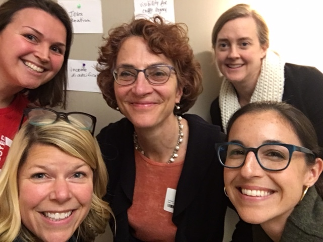 Starbucks Foundation staff celebrate after a successful strategy retreat facilitated by Anne Schonfield (center).
