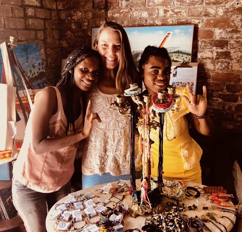 Faith (pictured center) working with Pazapa in Haiti to launch the  Solidarity Shop  -- giving Rose (left), Mireille (right) and other Haitians with disabilities the opportunity to earn a living.