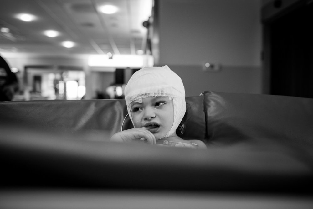 Arianna is wheeled through the Upstate Golisano Children's Hospital while recovering from her most recent brain surgery. At three years old, Arianna has gone through three brain surgeries in the past year and a half.