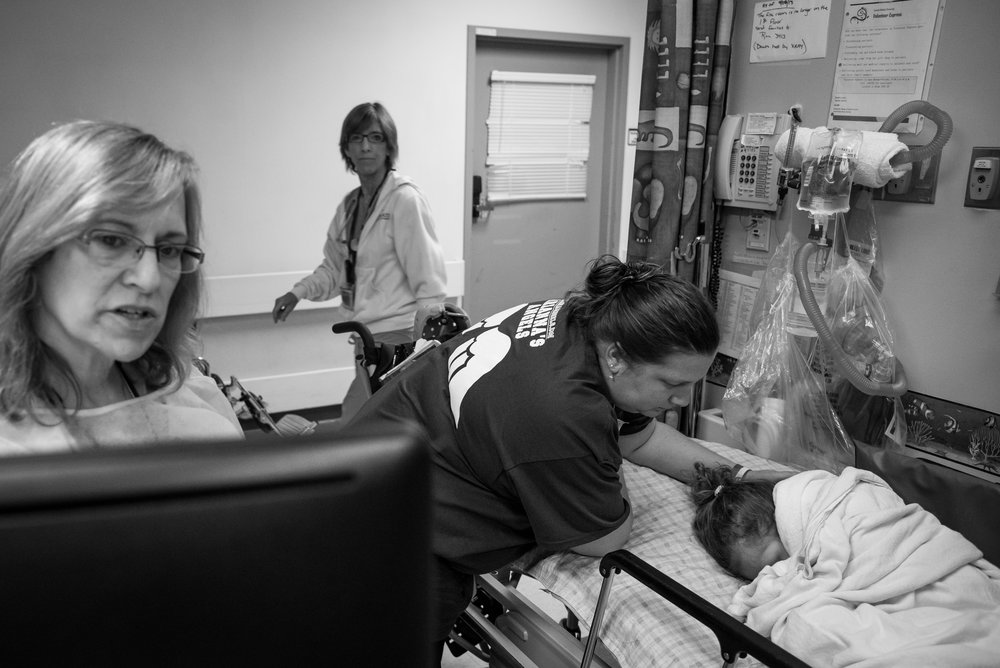 Jennifer Failla, Arianna's mother, comforts her as she wakes up from an anesthetic. Arianna was given an MRI to prepare for brain surgery, which was scheduled for a few weeks later.